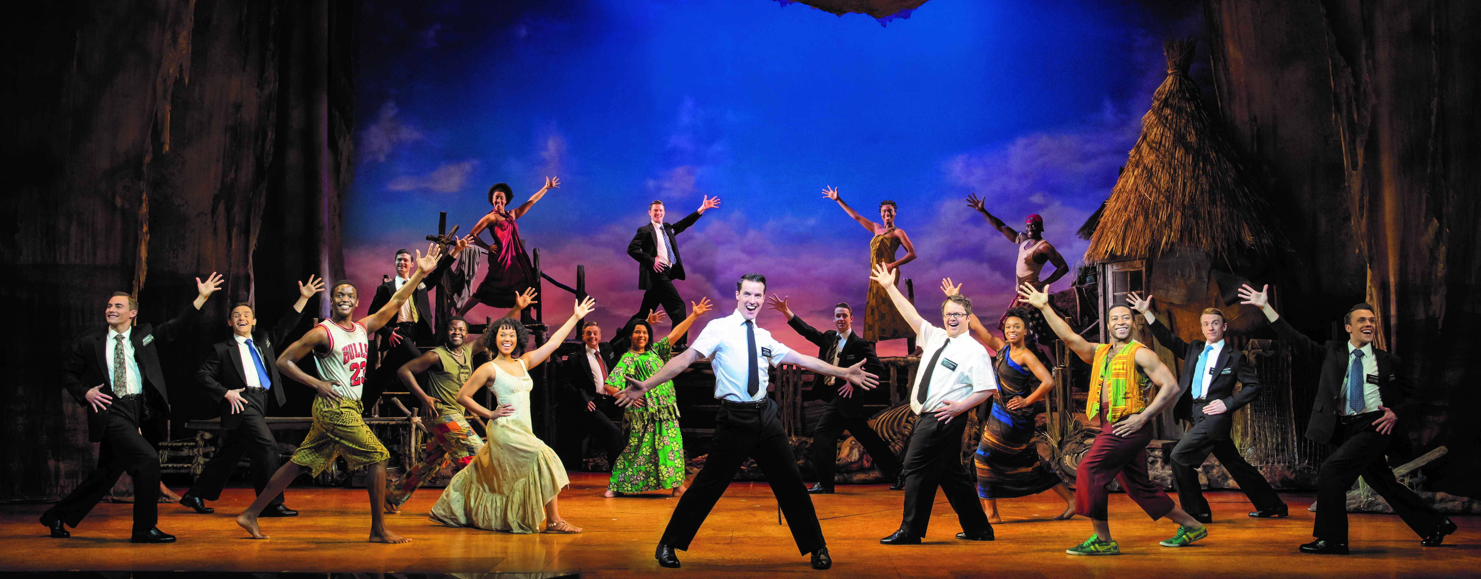Book of Mormon cast on stage